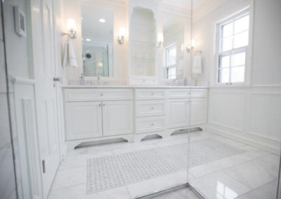 The shower and vanity of a completed bathroom renovation project