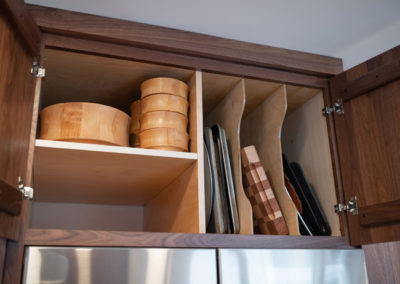 View inside a cabinet with storage organization