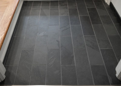 A close view of the floor tile work in a kitchen in Shaker Heights